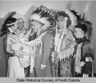 Norman Brunsdale receiving headdress