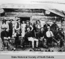 A.C. Huidekoper and cowboys in front of ranch house
