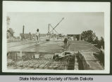 Pouring concrete slabs for approach to Liberty Memorial Bridge, Bismarck, N.D.