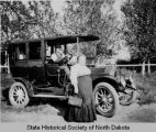 Ole Olson and Margareth Wigtil with Theodore Roosevelt's Buick limousine, Walcott, N.D.