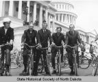Arthur A. Link and other legislators outside of U.S. Capitol with bicycles, Washington, D.C.