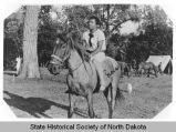 Era Bell Thompson on horseback, Mandan, N.D.