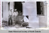 Workers with cornerstone, North Dakota state capitol building, Bismarck, N.D.