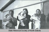 Unidentified woman, Sarah Snow, Dora Bear and babies, Fort Berthold Indian Reservation, N.D.
