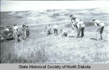 Children playing leapfrog, Fort Berthold Indian Reservation, N.D.