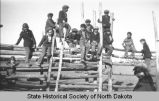 Boys on fence, Fort Berthold Indian Reservation, N.D.