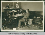 C.B. Little in office of First National Bank, Bismarck, N.D.