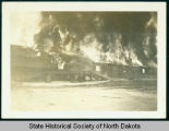 Garage fire at Civilian Conservation Corps camp near Watford City, N.D.