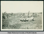 Blown over thresher after tornado, near Watford City, N.D.