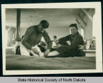 Barney Brunton and other men in barracks, Civilian Conservation Corps camp 2772 near Watford City,...