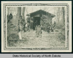 Civilian Conservation Corps crew at a log cabin