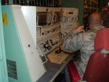 Soldier posed at control panel Oscar Zero missile alert facility near Cooperstown, N.D.