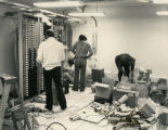 Northwestern Bell setting up circuit panels for State Radio System, Bismarck, N.D.