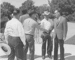 William L. Guy shaking hands with members of Prairie Riders Saddle Club