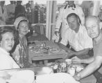 William Guy and Jean Guy eating with Farris and Julia Bryant on S.S. Independence