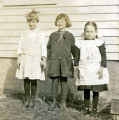 Amy Prall, Mary Johnson, and Carrie Jensen in front of house, Brantford, N.D.