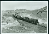 Steam and diesel freight train in the Badlands, Sully Springs, N.D.