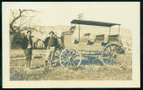 Mike Hoyt and unidentified engineer by a buggy, Medora, N.D.
