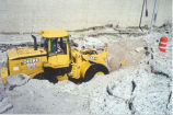 Bulldozer moving hail, Bismarck, N.D.