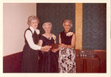 Ethel Weinrebe receiving Minot Sertoma Service award with daughters Nita and Donna Jane Weinrebe