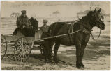 Mr. and Mrs. H.F. Beeman and Clark Beeman Sr. in a wagon, N.D.