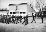 Soldiers wearing uniforms and police wearing riot gear march to Zip to Zap confrontation, Zap, N.D.