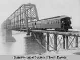 Train crossing Northern Pacific Railroad bridge, Bismarck, N.D.