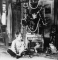 Elwell Treumann with Christmas tree, Grafton, N.D.