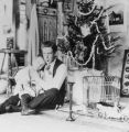 W.K. and Elwell Treumann sitting on floor next to Christmas tree, Grafton, N.D.