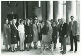 Republican legislators' wives presenting wheelchair to Governor Allen Olson for use in the capitol, Bismarck,