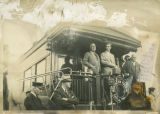 Governor Walter Welford with Franklin Delano Roosevelt on back of NPRR train on campaign trail,...