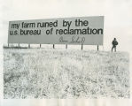 Man with anti-Bureau of Reclamation billboard