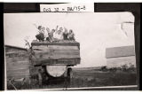 Girls on Otto Hemp's water wagon, Barnes County, N.D.