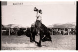 Bronc doing the jacknife, Medora, N.D.