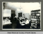 Staff of the traveling library department of the Public Library Commission in their office,...