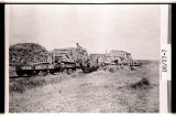 Unloading railroad ties for Killdeer branch near Dunn Center, N.D.