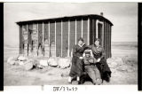 Nora Rust, Marie Johnson, and Knute Severson at Rust's homestead shack, Alkabo, N.D.