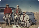 Hunters with game birds from the day's hunt