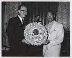 Governor William L. Guy and Buzz Aldrin holding Great Seal of North Dakota, Bismarck, N.D.