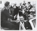 William L. Guy and Quentin Burdick with President John F. Kennedy in car, University of North Dakota,