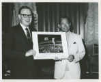 Governor William L. Guy and Buzz Aldrin holding photograph of astronaut on moon, Bismarck, N.D.