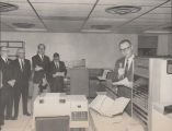 William L. Guy and others with new state computer system, Bismarck, N.D.