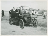 Congressman Rolland Redlin, Secretary of the Interior Stewart Udall and Quentin Burdick in Ford automobile