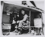 Walter Hjelle, election observer, in helicopter, Vietnam