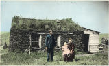 Ole Myrvik's sod house, Milton, North Dakota, Mr. & Mrs. Ole Myrvik and child.