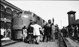 Crowd around Great Northern EMD type E-7 locomotive at depot, Fargo, N.D.