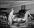 Waitresses clearing tables at the Powers Hotel Coffee Shop, Fargo, N.D.