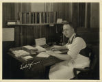Dr. Evans at his desk in Demonstration office