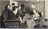 G. Angus Fraser family listening to radio broadcast in their home, Fargo, N.D.