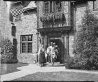 Crown Prince Olav and wife Martha of Norway leaving the home of L. B. Hanna, Fargo, N.D.